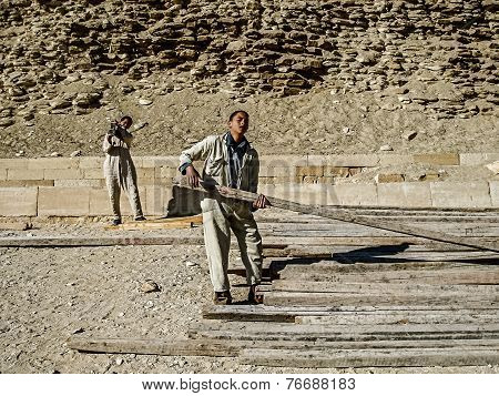 Young Men Working on the Pyramids