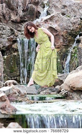 Girl Walking On The Stones