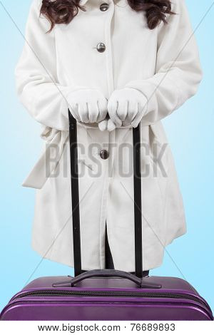Woman In Winter Coat Holding A Luggage