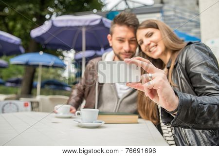 Couple Taking A Selfie In A Bar