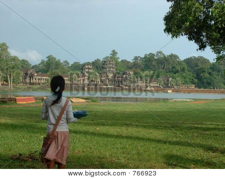 Girl looks on at Angkor Wat in Cambodia