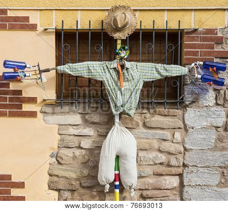 scarecrow hanging on a wall