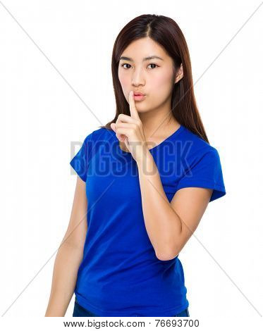 Woman with silence sign on lip