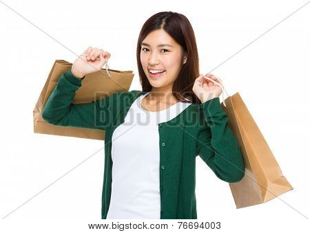 Thrilled woman with shopping bag