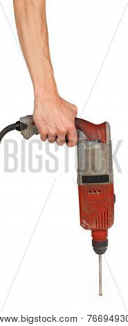 Man's Hand Holds A Brown Drill