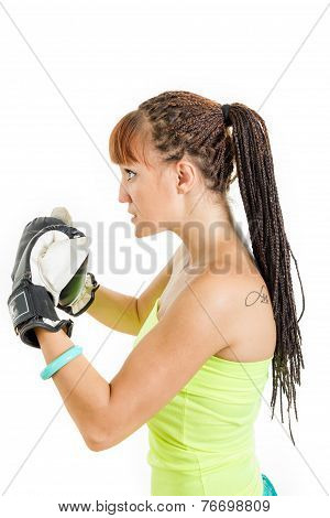 Angry Girl In Rage Wearing Boxing Gloves Ready To Fight And Standing Aside In Combat Position