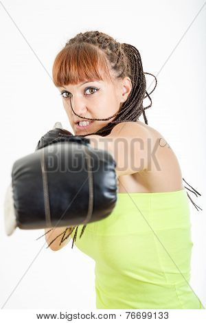 Girl In Rage Wearing Boxing Gloves Ready To Fight And Punching Or Hitting Camera Or You
