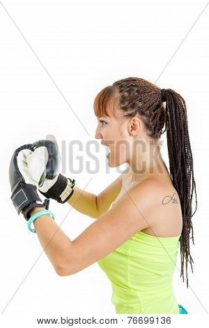 Girl In Rage Wearing Boxing Gloves Ready To Fight And Standing Aside In Combat Position
