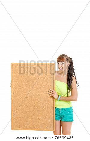Pretty Young Woman Holding Blank Cork Board Smiling