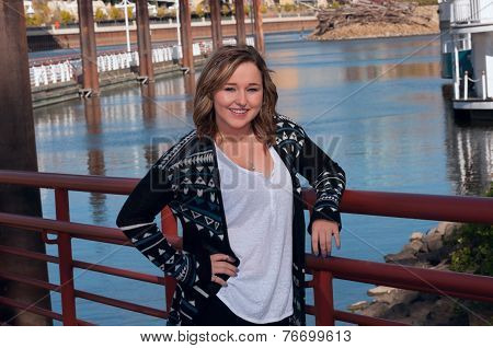 Teen Female Model Smiling Along Riverfront