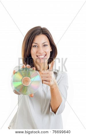 Woman Holding Up Compact Disc Or Cd And Looking At Camera With Thumbs Up