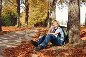 image of schoolboys  - schoolboy with backpack after school in park - JPG