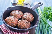 pic of pork cutlet  - cutlets in pan and on a table - JPG