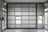 picture of section  - Sectional motorized big metal garage doors and small door - JPG
