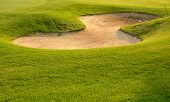 foto of trap  - Golf sand trap with greenish grass around - JPG