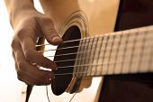 stock photo of fret  - Playing guitar strings and frets for making music - JPG