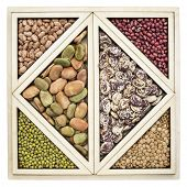 picture of tangram  - a variety of beans and lentils in an isolated wooden tray inspired by Chinese tangram puzzle - JPG