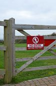 picture of no entry  - No entry sign attached to a wooden five bar gate in a rural setting - JPG