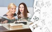 foto of jewel-case  - Two women looking at showcase with jewelry at jeweler - JPG