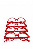 picture of bifocals  - Stack of red glasses isolated on white - JPG