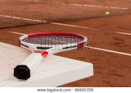 Tennis Racket On The Table, Clay Court, Tennis Net And Ball