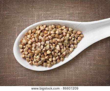 Buckwheat Groats In White Porcelain Spoon / High-res Photo Of Grain In White Porcelain Spoon On Burl