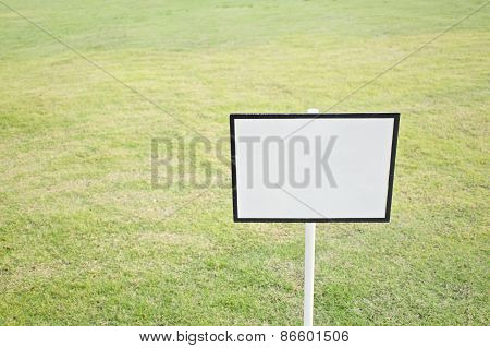 Empty Black And White Sign Board On Green Grass
