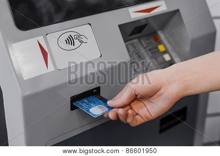 Woman Hand  Put Credit Card Into Atm