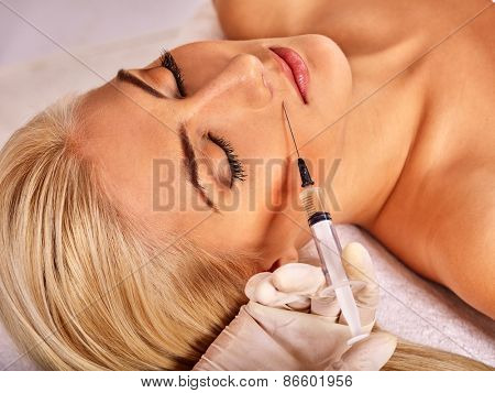 Doctor woman giving botox injections. Visible hand.