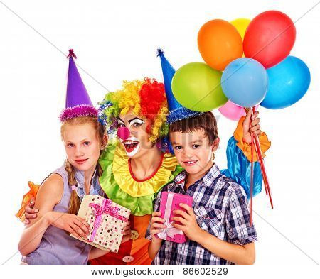 Birthday party group of teen people with female clown taking balloons . Isolated.