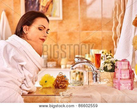 Woman relaxing at home luxury bath. Girl looks at camera.