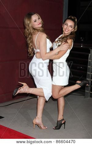 LOS ANGELES - MAR 27:  Hunter King, Lexi Ainsworth at the