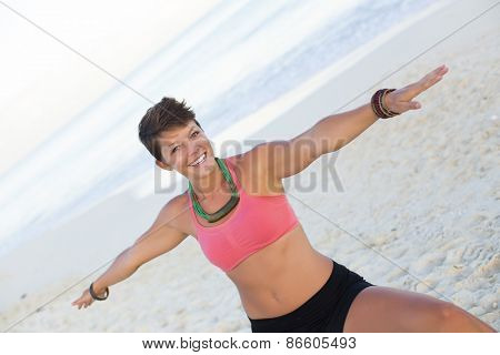 Woman practicing yoga at the beach - soft colors,
