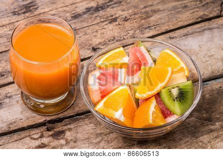 Fresh Fruit Salad With Glass Of Juice