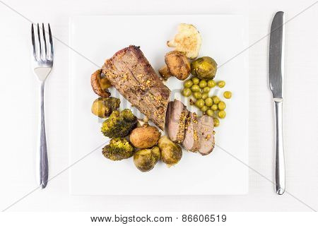 Roast Beef With Grilled Vegetables On Served Table