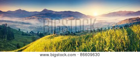 Fantastic foggy day and bright hills by sunlight. Dramatic morning scenery. Carpathian, Ukraine, Europe. Beauty world. Retro and vintage toning effect.