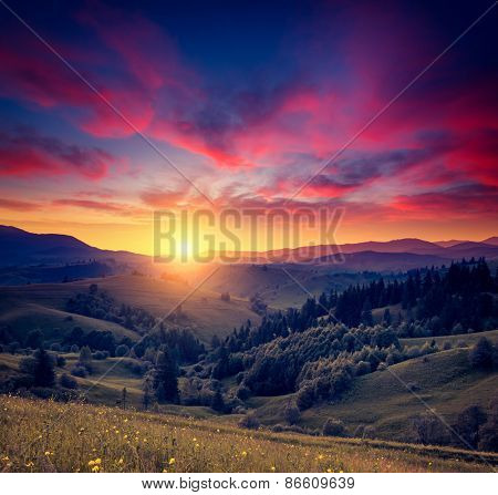 Great hills glowing by warm sunlight at twilight. Dramatic scene. Colorful sky, red clouds. Carpathian, Ukraine, Europe. Beauty world. Retro and vintage style, soft filter. Instagram toning effect.