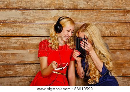 Sisters Listening To Music On Headphones