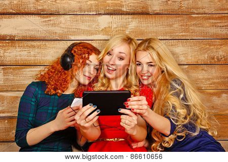Sisters Listening To Music On Headphones And Make Selfie