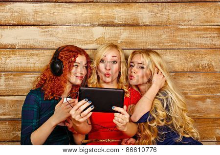 Sisters Make Fun Selfie, Listening To Music On Headphones