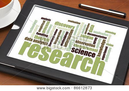 scientific  research word cloud on a digital tablet - science concept