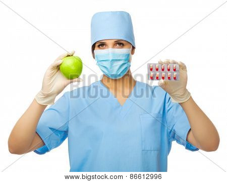 Young doctor with apple and pills isolated