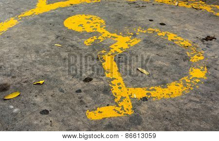 image of old Handicapped symbol on parking space.