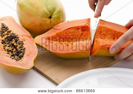 First Cut Through A Hollowed Out Papaya Half
