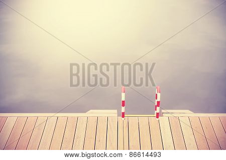 Retro Vintage Filtered Wooden Pier And Ladder.