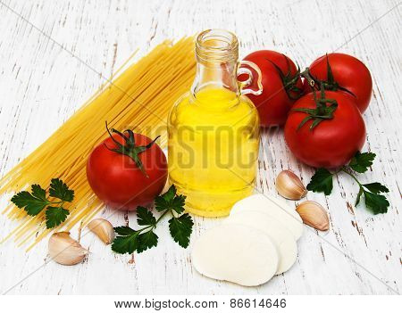 Olive Oil, Mozzarella Cheese, Spaghetti, Garlic And Tomatoes