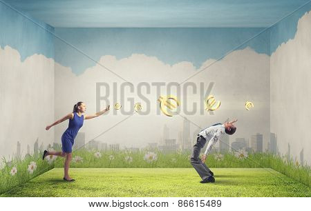 Two business people fighting with each other