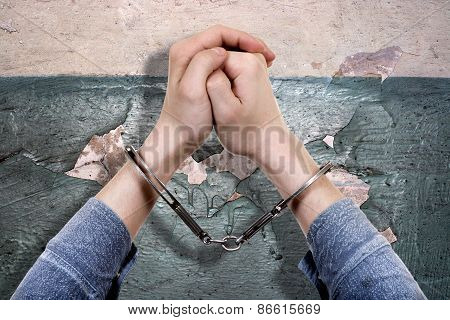 Handcuffs On The Hands Closeup