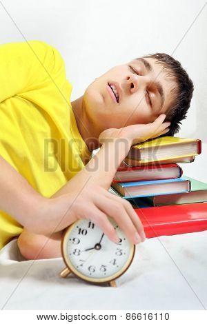 Tired Student Sleep With Alarm Clock
