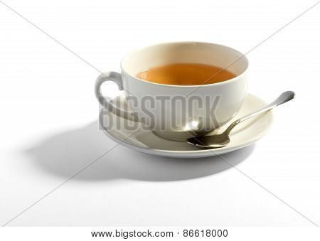 Milky Tea In A Cup With A Teaspoon